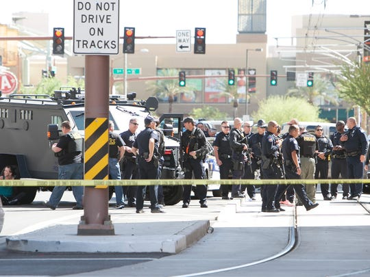 Phoenix police officers at the scene of Craig Uran's