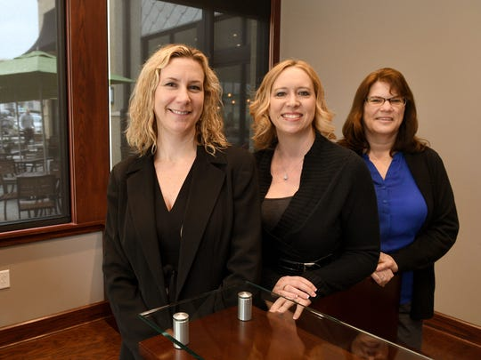 Capstone Concepts associates Mandy Edwards, left, Valerie Bolar and Julie Stier in their offices on Bearden Hill on  Tuesday, Feb. 28, 2017.