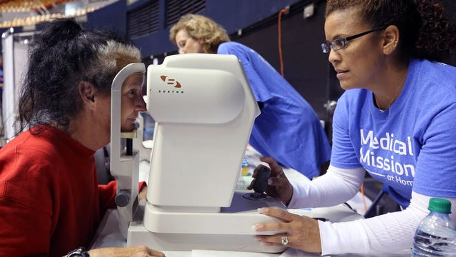Debbie Rowe, a Nashville resident, receives a vision screening at Saint Thomas Medical Mission at Home on Saturday at Municipal Auditorium