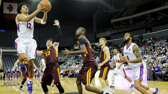 Evansville Aces guard Dru Smith (12) shoots past Loyola