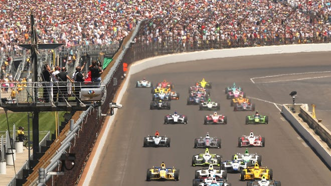 The green flag drops at the Indianapolis Motor Speedway for the start of the Indianapolis 500 on Sunday morning, May 25, 2014.