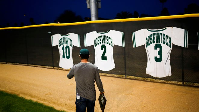 Arizona Diamondbacks catcher Tuffy Gosewisch looks at his newly retired number 2 next to his brother's at  Horizon High School on Tuesday, March 15, 2016.