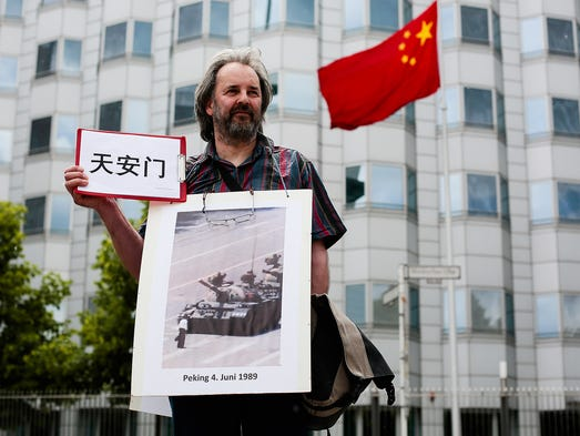 A protester demonstrates against the China's brutal 1989 Tiananmen Square crackdown in front of the Chinese Embassy on June 4 in Berlin. A group of demonstrators staged a rally to mark the 25th anniversary of a military attack on pro-democracy protesters at Tiananmen Square in Beijing.