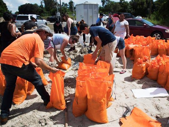 San Carlos Park residents fill sandbags in preparation