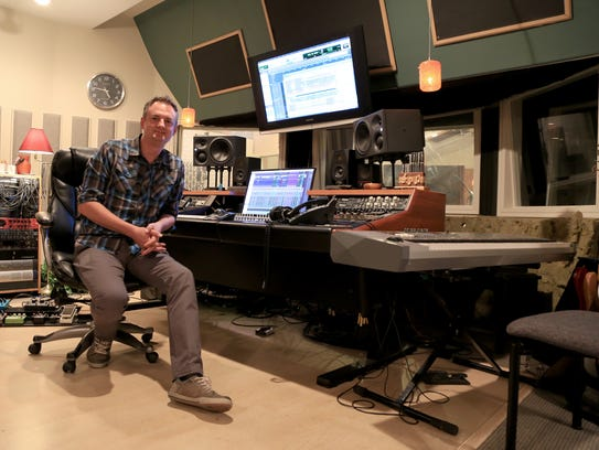 Ryan Tilby sits in Spiral Studios in St. George, where