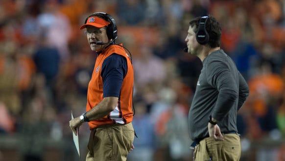 Auburn head coach Gus Malzahn talks to Auburn defensive