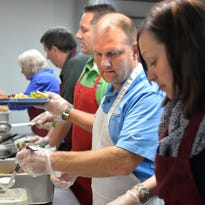 Premier Real Estate Services employees from left, Diane Huben, Randy Northey, Jason Miller, Noel Johnson, and Kristi Moulzolf serve lunch for the homeless Monday, Nov. 23 at the St. Cloud Salvation Army Shelter. Premier provides the lunch and serves it as part of the PhilanthroFEED program at the shelter.