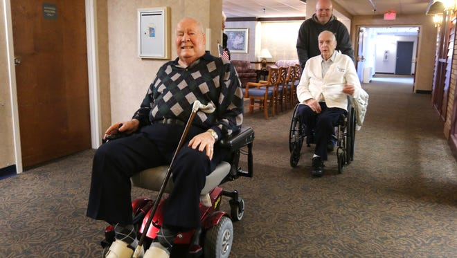 Seventy one years fell away as two old friends, Paul Ruberg, left, and Roy Romes, both 90, reunited at Ruberg's home in the Western Hills Retirement Village. Romes lives in Fort Wright. They graduated from Elder High School in 1943 and joined the Navy together. They lost touch after World War II.
