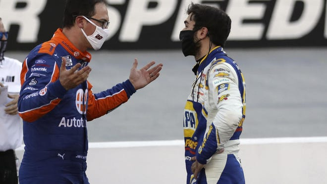 Drivers Joey Logano, left, and Chase Elliott talk over their crash near the end of NASCAR Cup Series race at Bristol Motor Speedway Sunday. MARK HUMPHREY/AP