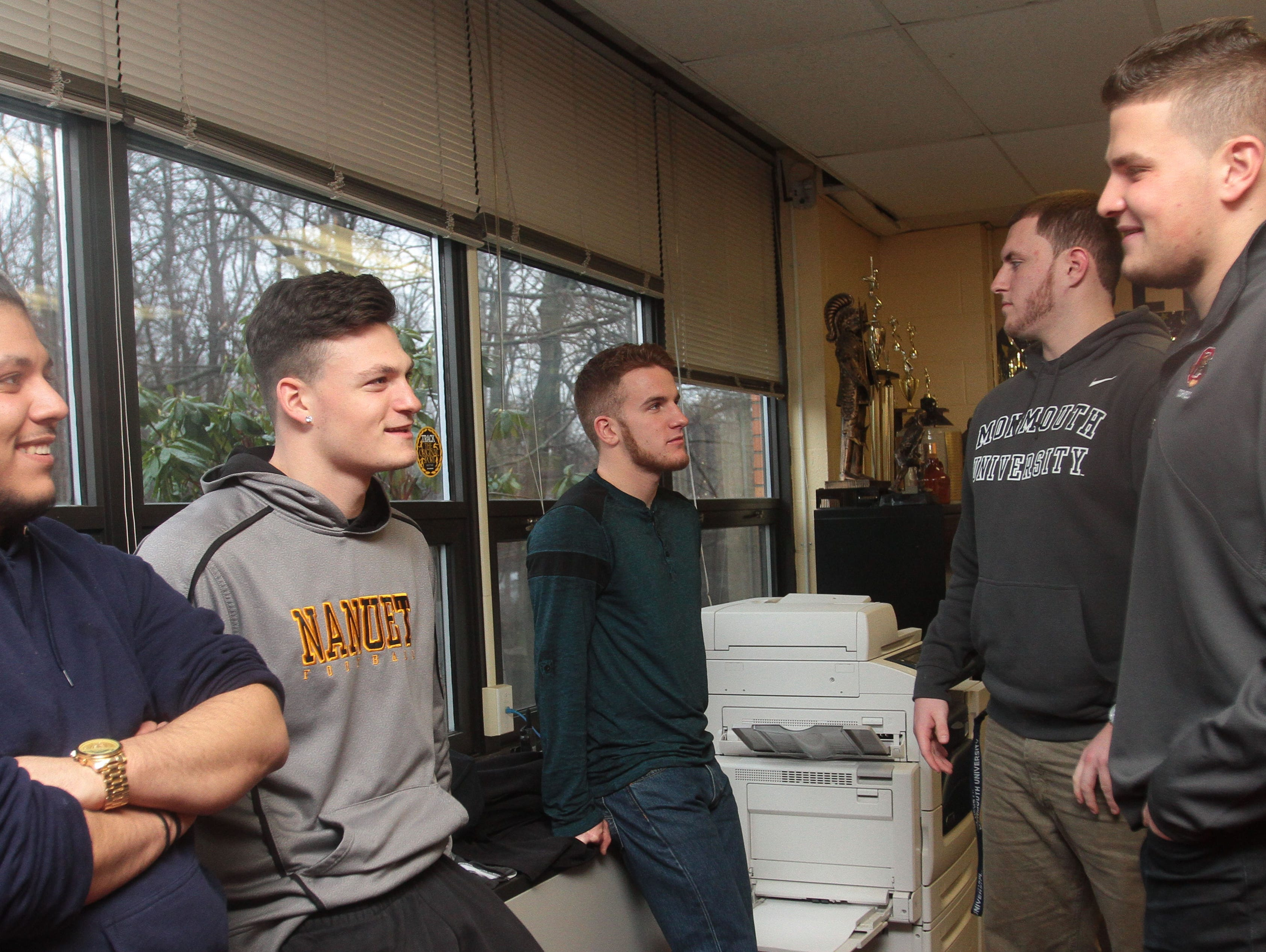 (From left to right) Benny Mendoza, Matt Levine and Brian McGreevy friends of Brian Syracuse and Jordan Landsman, waits with Brian and Jordan prior to them signing on to their colleges on Feb. 3, 2016 at Nanuet Senior High School.