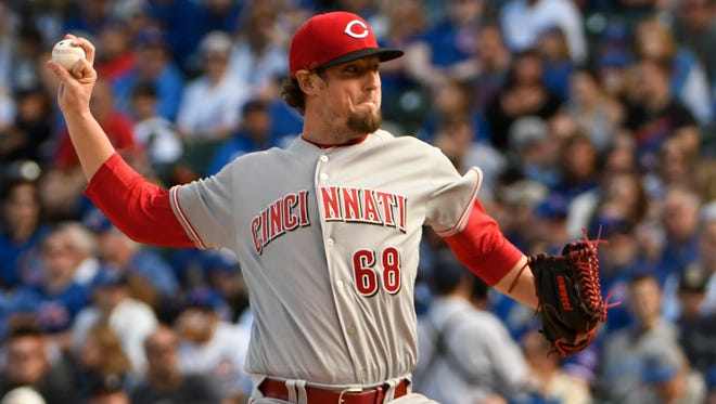 Cincinnati Reds starting pitcher Deck McGuire (68) throws the ball against the Chicago Cubs during the first inning of the game Sunday, Oct. 1, 2017, in Chicago.