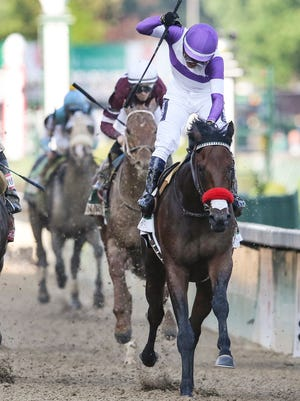Jockey Mario Gutierrez celebrates Nyquist to win the Kentucky Derby.
