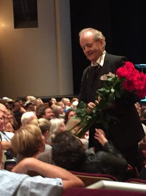 Bill Murray walks through the middle of the crowd to distribute roses at the McCallum Theatre Saturday.