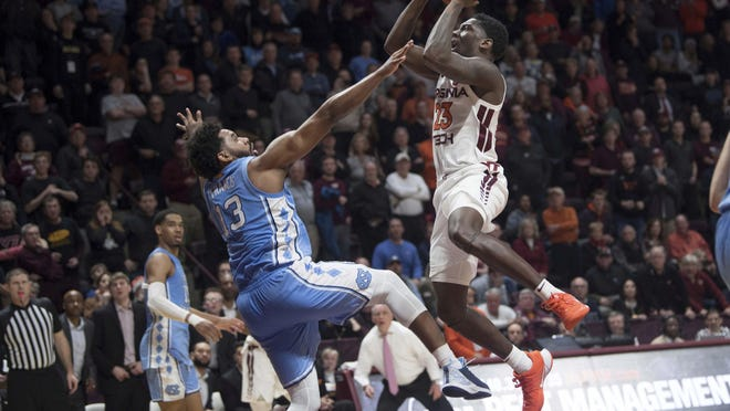 Virginia Tech guard Tyrece Radford (23) shoots the game-winner to beat North Carolina in double overtime as Jeremiah Francis (13) defends.