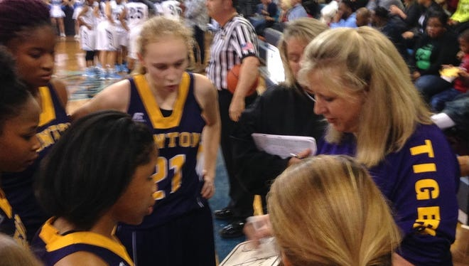 Benton's Mary Ward gives instruction to her team during a timeout on Monday night.