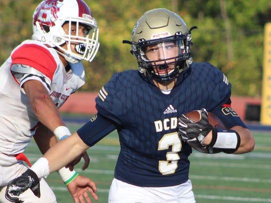 DCD's junior quarterback Anthony Toma (3) picks up