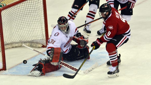 St. Cloud State's Joey Benik watches a shot as Nebraska-Omaha