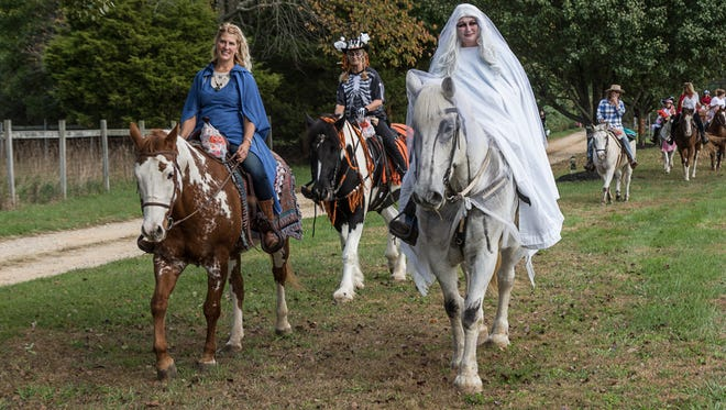 (From left) Donna Camilli and Denver, Marilyn Sabatino and Troy, Dotty Orzechowski, owner of Circle D Farm in Bridgeton, and Johnny lead the way during Circle D Farm's annual Halloween parade.