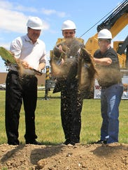 From left, Gary Jones, a regional UAW director; Wentzville (Mo.) Mayor Nick Gucione and UAW 2250 Chairman Mike Bullock  break ground for an expansion of GM's Wentzville assembly plant in 2012.