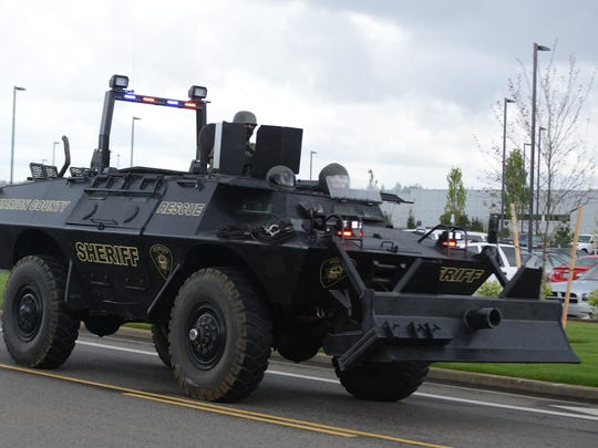 Police bring in more armored vehicles during a shootout and standoff on Friday, April 24, 2015, in the parking lot of Walmart along Turner Road in Salem.