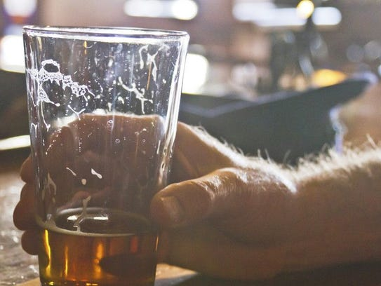 In this photo, a glass of alcohol is set down at a