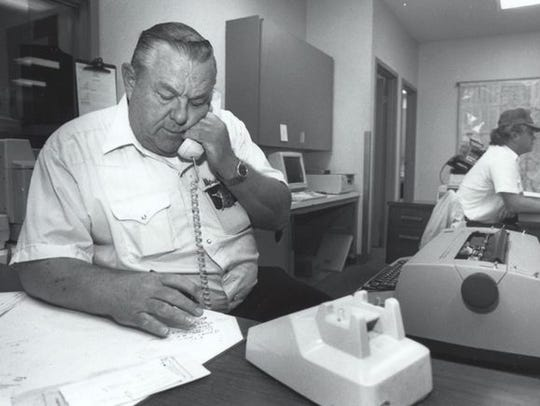 Sheriff's Deputy Lou Hargraves takes a phone call after