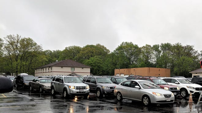 Cars line up to receive food on May 22 as Springfield and Lakemore first responders, along with Grace Cathedral, passed out more than 1,000 boxes of food.