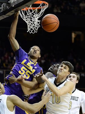 LSU guard Tim Quarterman (55) is fouled during a game against Vanderbilt.