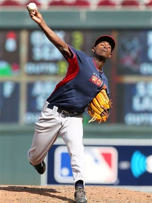 World's pitcher Luis Severino throws a pitch during the All-Star Futures baseball game against Team United States, Sunday, July 13, 2014, in Minneapolis. (AP Photo/Jim Mone)