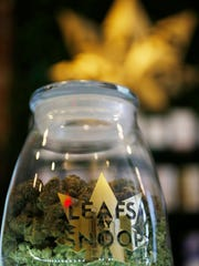 FILE - This Friday, Dec. 18, 2015, file photo shows the label on a jar in the marijuana line marketed by rapper Snoop Dogg in one of the LivWell marijuana chain's outlets south of downtown Denver. The rapper is not the only celebrity with a marijuana line as others, such as Willie Nelson and descendants of Bob Marley, are scrambling to brand and trademark pot products in the industry as it becomes part of the mainstream.