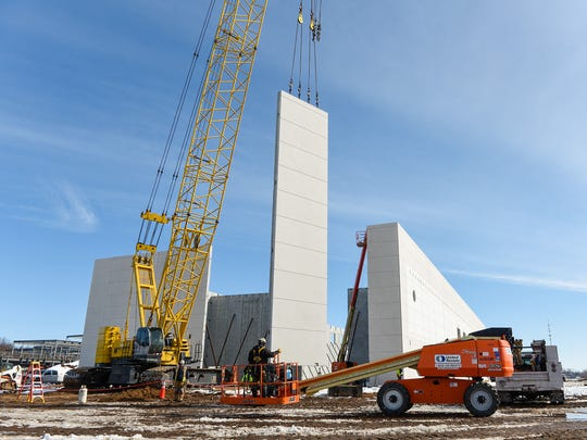 Concrete panels are moved into place for the main and