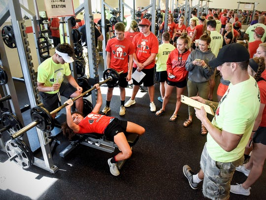 Area athletes lift their best weight for the judges