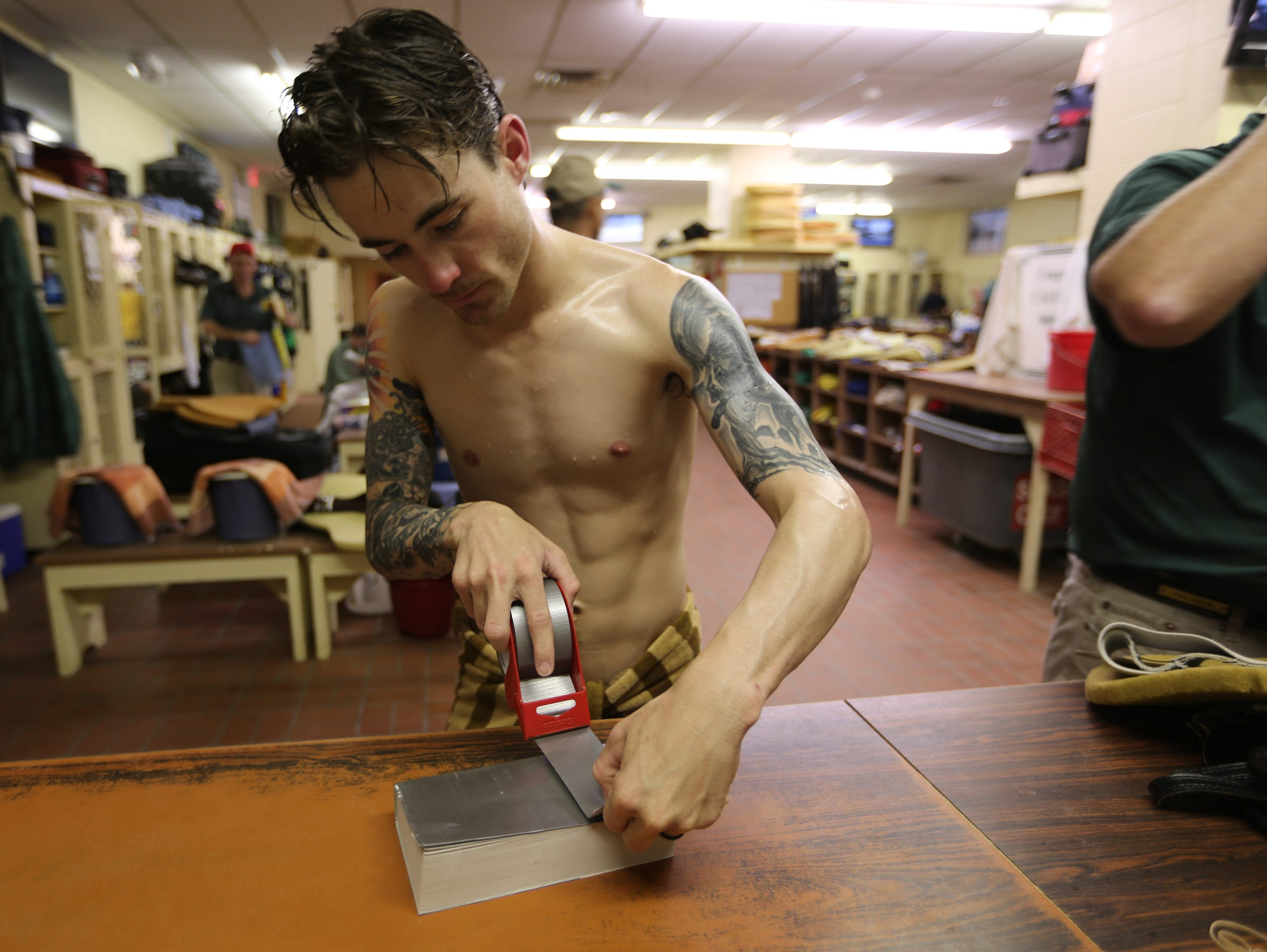 Jockey Channing Hill places duct tape on his novel