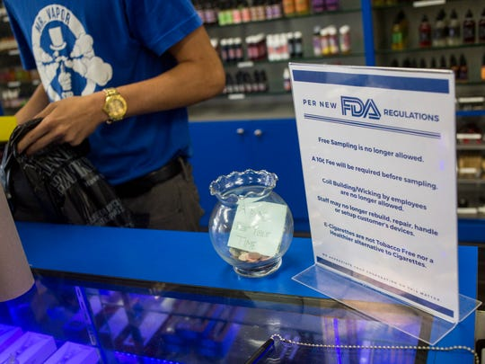 A sign outlines new FDA regulations Friday, August 12, 2016 at Mr. Vapor in Port Huron.