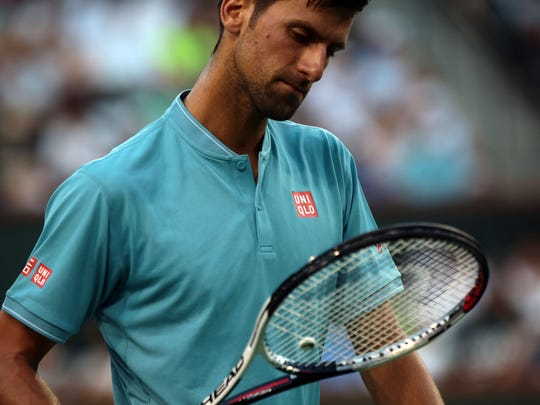 Novak Djokovic, of Serbia, changed racquets several times during his match against Kyle Edmund, of Great Britain, in the men's 2nd round of the BNP Paribas Open on Sunday, March 12, 2017 in Indian Wells.