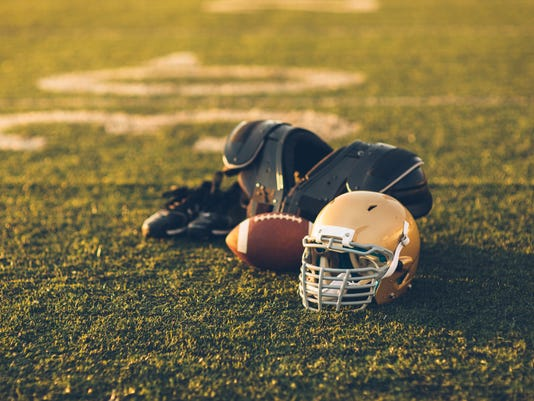 Gold Football Helmet on Field