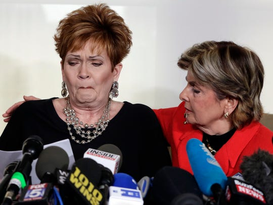 Beverly Young Nelson, left, the latest accuser of Alabama Republican Roy Moore, reads her statement as attorney Gloria Allred looks on, at a news conference in New York, Nov. 13, 2017.