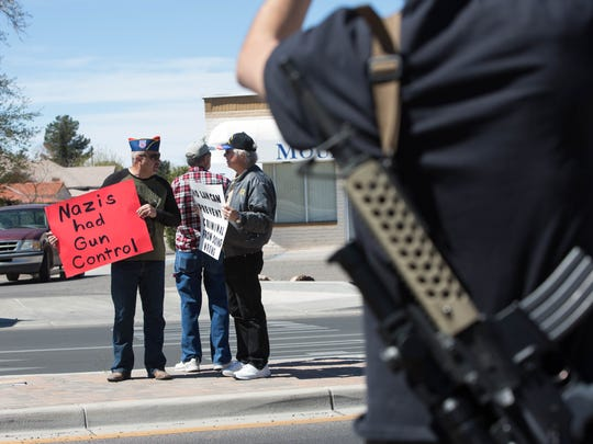 Gun rights activists, many armed with weapons stood outside of the Las Cruces City Hall, Monday March 19, 2018, to protest the Las Cruces City Council's proposed statement of support for restrictions on the sale or possession of semi-automatic weapons.