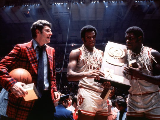 Bob Knight with the winning basketball and Scott May (42) and Quinn Buckner (21) celebrate thier NCAA Final Four men's basketball championshp.