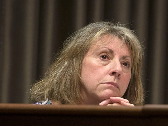 Then-Buncombe County Manager Wanda Greene listens in