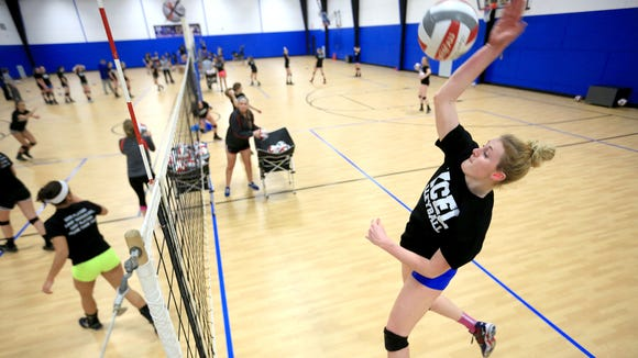 West Henderson junior Taylor Houck goes up to hit a ball Wednesday night during practice for the Xcel Volleyball Performance 18X Select team.
