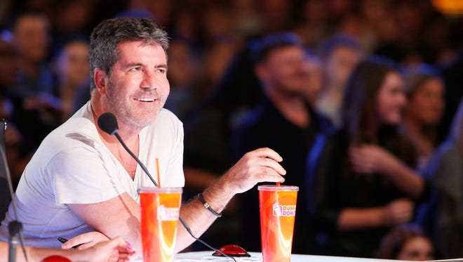 Simon Cowell, 'America's Got Talent's' new judge and executive producer, watches an audition during a show taping in Pasadena, Calif.