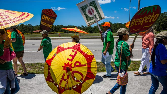 Protesters call for Publix to join the Coalition of Immokalee Workers' Fair Food Program outside of the Orangetree Publix on Sunday, May 7, 2017.