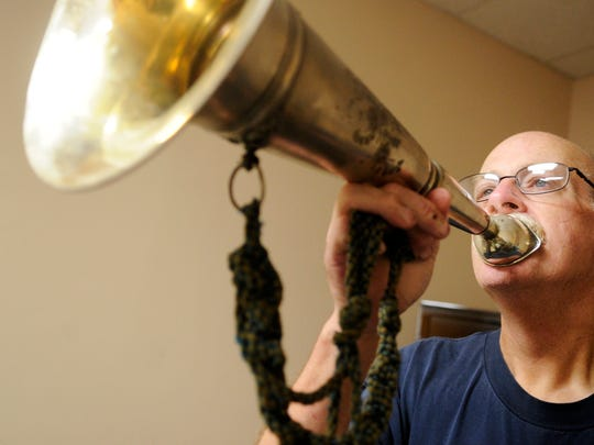 In this 2012 file photo, Byron Good demonstrates how firefighters would use the speaking horn to send commands to other firefighters before there were radios to relay messages. Good was a lifetime member of the Liberty Fire Company in North York.
