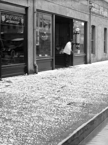 Hail fell on East Adams Street in Phoenix in late afternoon March 12, 1917. Less than two years later, it snowed a bit downtown.