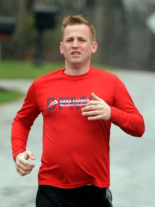Tom Duffy runs near his Springettsbury Township home Tuesday, April 14, 2015. He is training for the Boston Marathon and will be running the race with the mother of a Boston man who donated lifesaving bone marrow to his son Joey two years ago. Joey suffered from a bone marrow disorder. Bill Kalina - bkalina@yorkdispatch.com