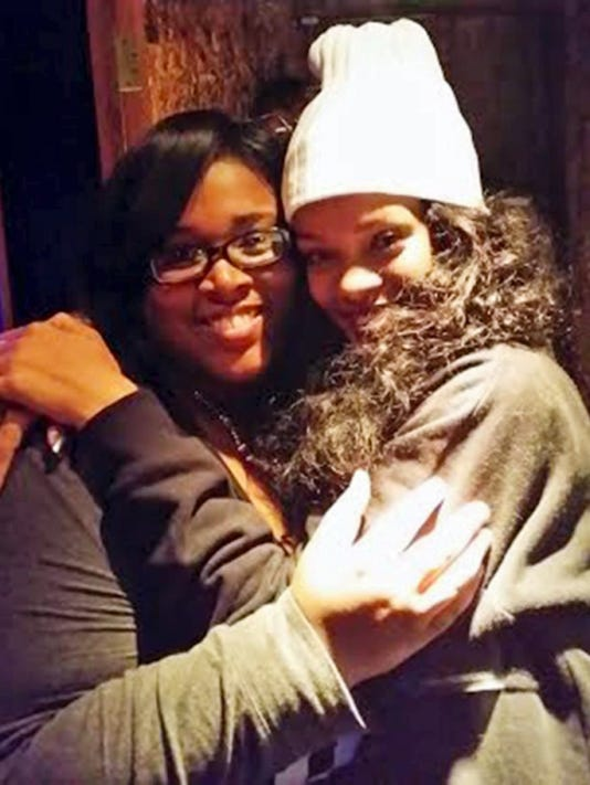 """William Penn Senior High School graduate Alicia Renee Williams (left) hugs singer Rihanna. Williams' song """"As Real As You And Me"""" will be featured in Rihanna's upcoming animated film """"Home."""""""