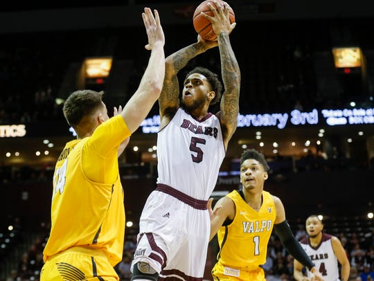 Obediah Church, of Missouri State, puts up a shot during