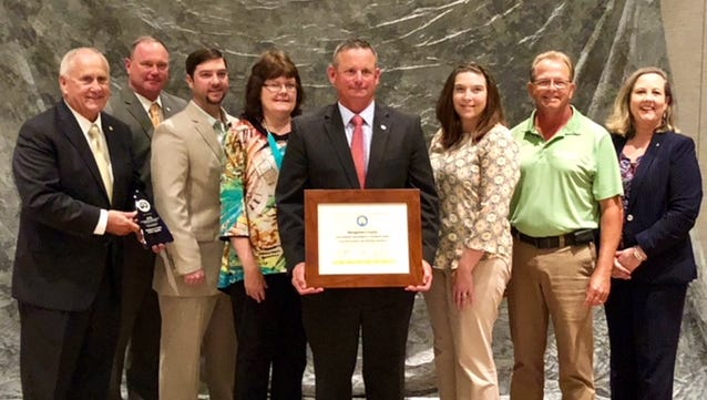 Pictured from left to right are: Deputy Governor Jim Henry, County Chief of Staff Jeff Truitt, County Engineer Nick Powell, County Administrative Assistant Emily Mathews, County Mayor Jim Durrett, CMC Green Certification Manager Carlye Sommers, County Facilities Manager Kenneth Gentry and TDEC Commissioner Shari Meghreblian.