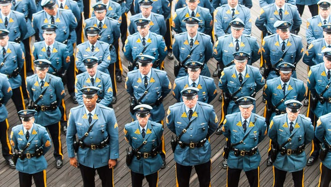 New Jersey State Troopers take one final moment to say goodbye and pay respects to fallen New Jersey State Trooper Frankie Williams held at Boardwalk Hall in Atlantic City on Monday, December 12.